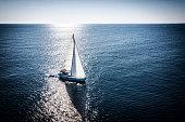 Sailboat during sailing. High angle view photo from drone DJI Mavic 2 Pro (Hasselblad camera).