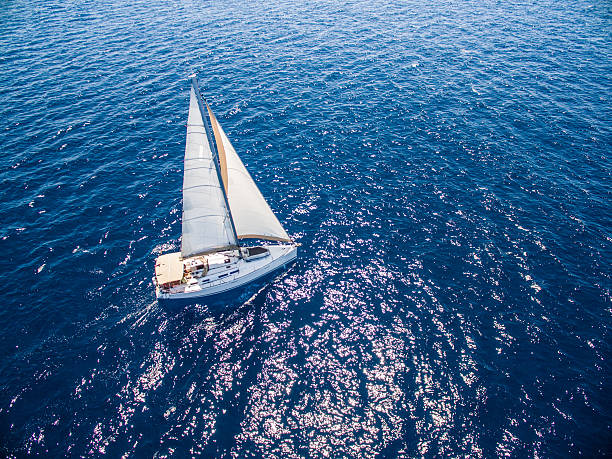 Sailing with sailboat, view from drone stock photo