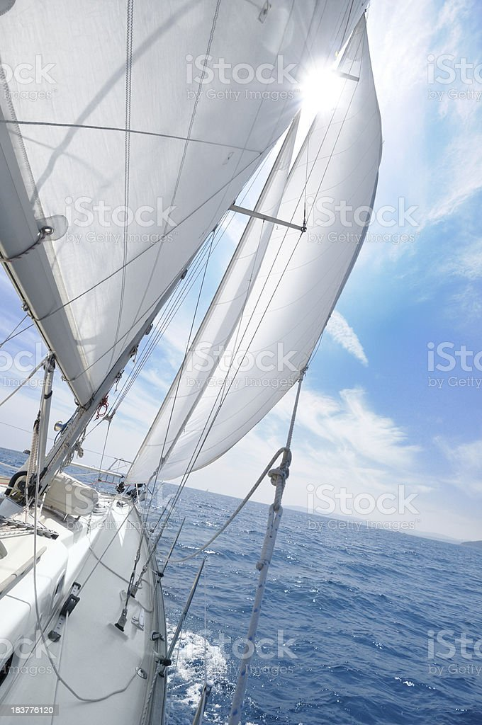 Sailing with sun in sails royalty-free stock photo