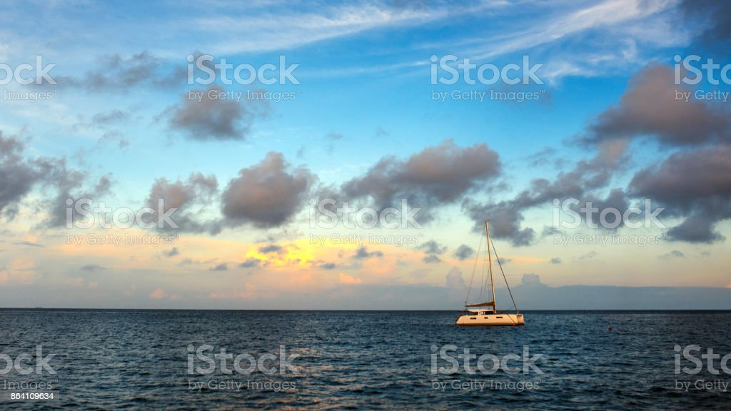Sailing yacht at sunrise royalty-free stock photo