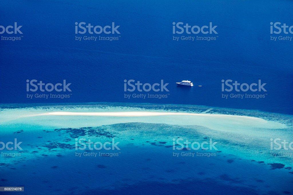 Sailing yacht at the North Ari Atolls in the Maldives stock photo