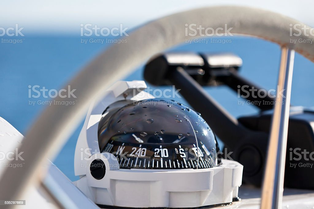 Sailing yacht control wheel and implement stock photo