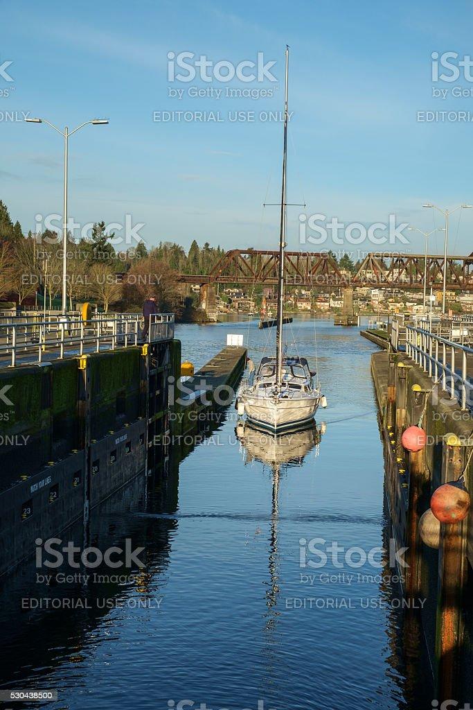Sailing yacht entering locks stock photo