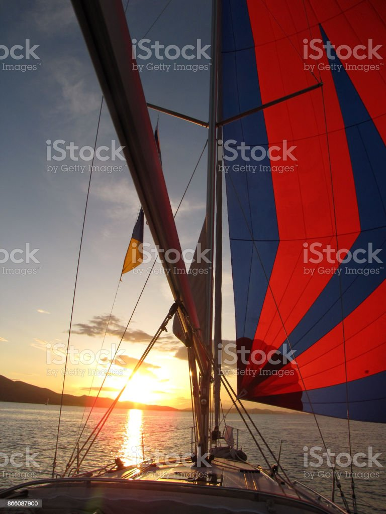 sailing yacht in sunset stock photo