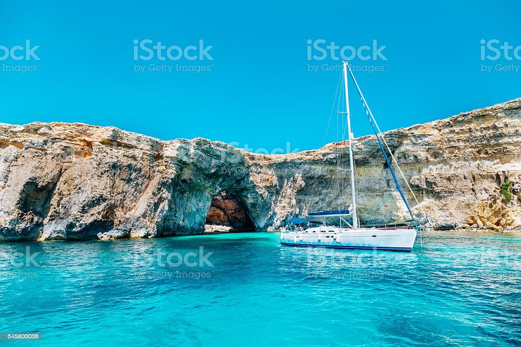 Sailing yacht in the Crystal lagoon, Comino - Malta stock photo