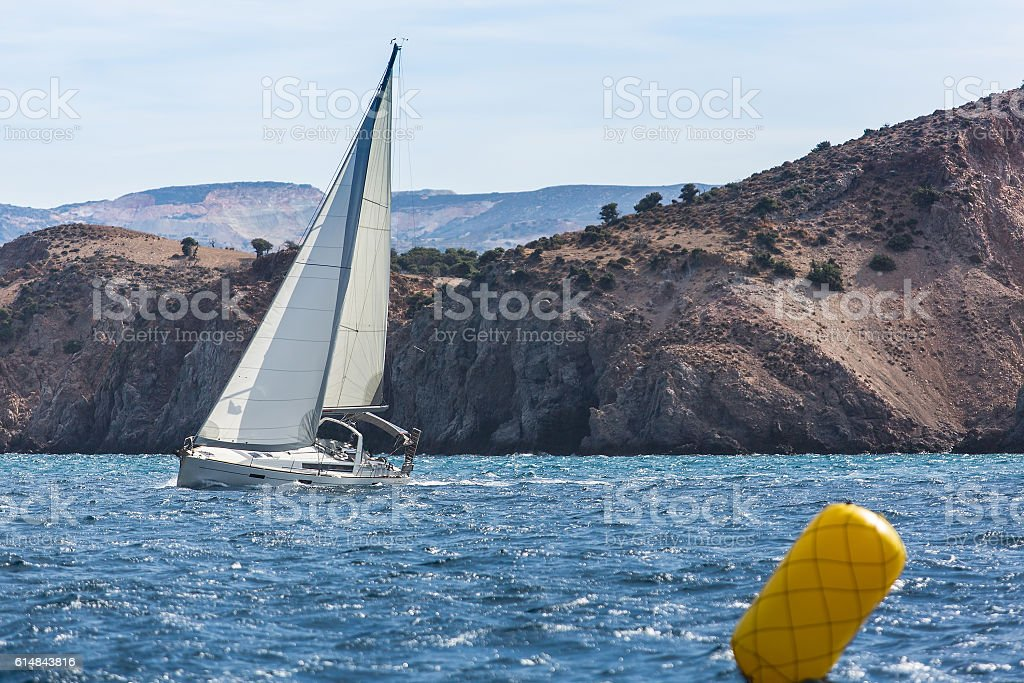 Sailing yacht in the finish during the race regattas stock photo