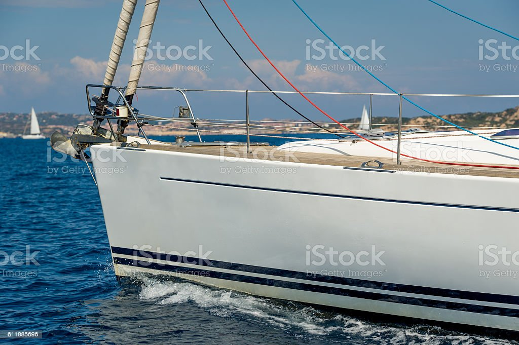 Sailing yacht under the engine, bow close view. stock photo