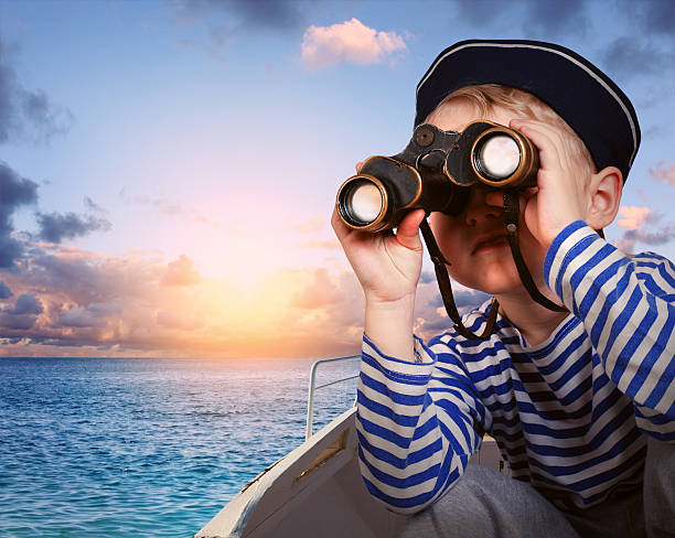 sailor boy with binoculars in the boat - binocular boy bildbanksfoton och bilder