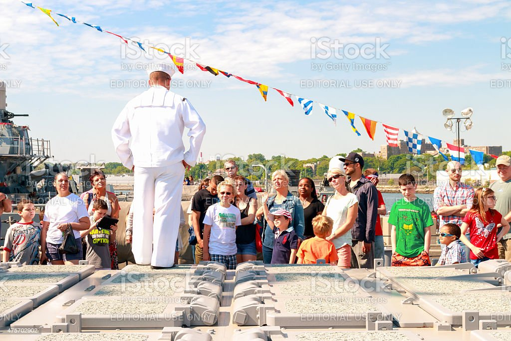 Sailor gives  tour of  USS Stout during Fleet Week. stock photo