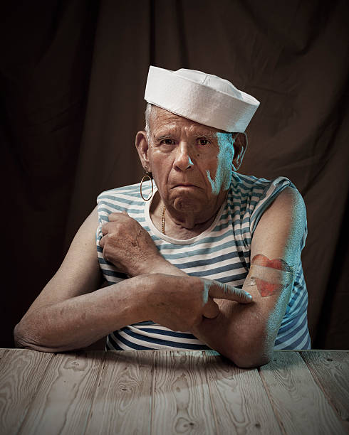 Sailor grandfather Old mad showing his tattoos sailor stock pictures, royalty-free photos & images