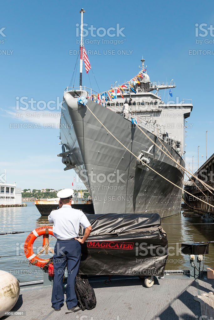Sailor in front of the USS Oak Hill - NYC stock photo