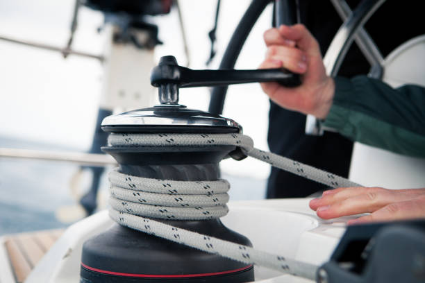 sailor pulling rope, outdoor activities, sailboat sport race - cable winch stock photos and pictures