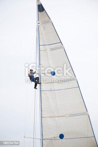 1011210354istockphoto Sailor repairing on sail 185234754