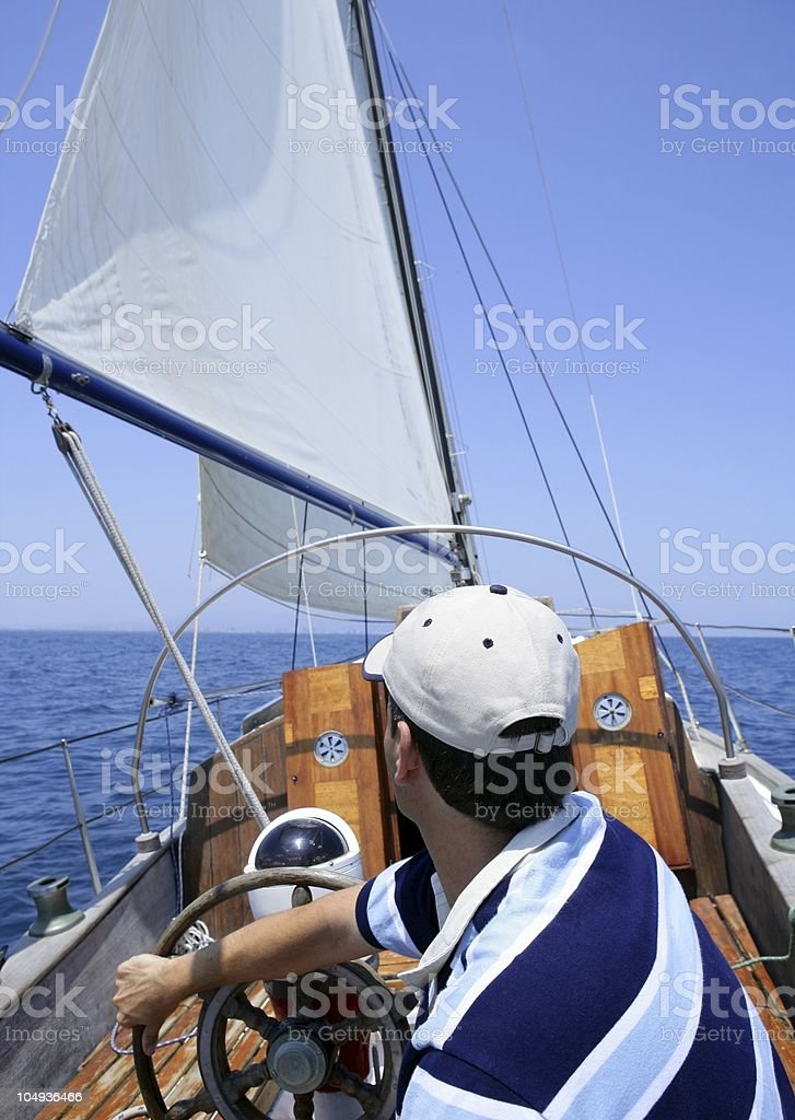 Sailor sailing in the sea. Sailboat over blue royalty-free stock photo