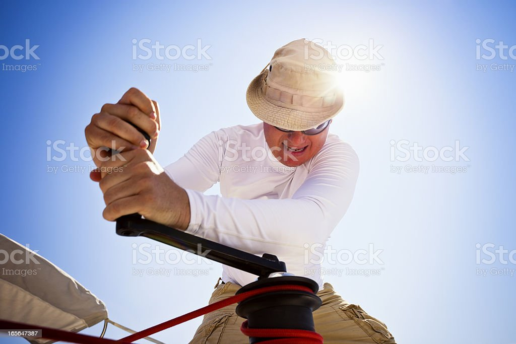 Sailor winding rope with winch - Royalty-free Activity Stock Photo