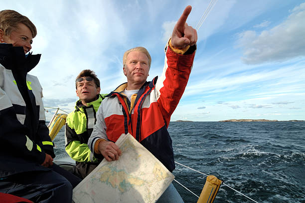 Sailor with a chart in his hand pointing forward stock photo