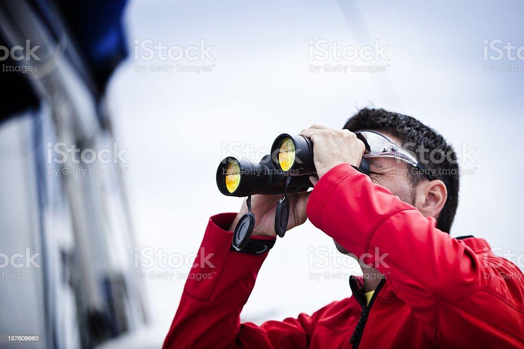 Sailor with binoculars on sailboat - Royalty-free 30-39 Years Stock Photo