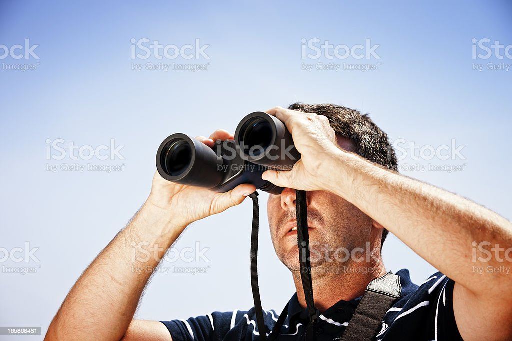 Sailor with binoculars on sailboat - Royalty-free 30-39 Years Stock Photo