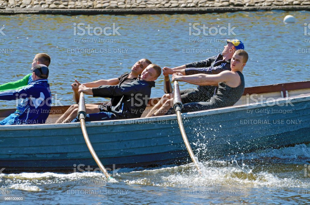 Sailors compete on rowing boats. - Royalty-free Adrenaline Stock Photo