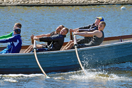 Sailors Compete On Rowing Boats Stock Photo - Download Image Now