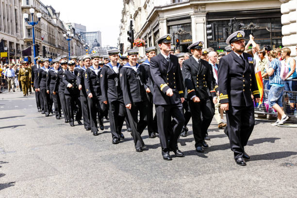 sailors of the royal navy march in the armed forces day parade in london uk - uk military stock photos and pictures