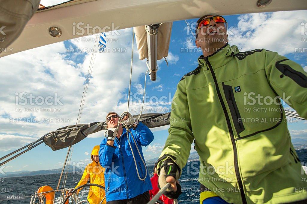 Sailors participate in sailing regatta stock photo