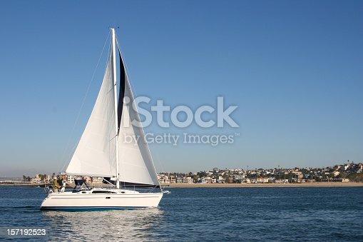 Large 30+ ft sailboat on California coast