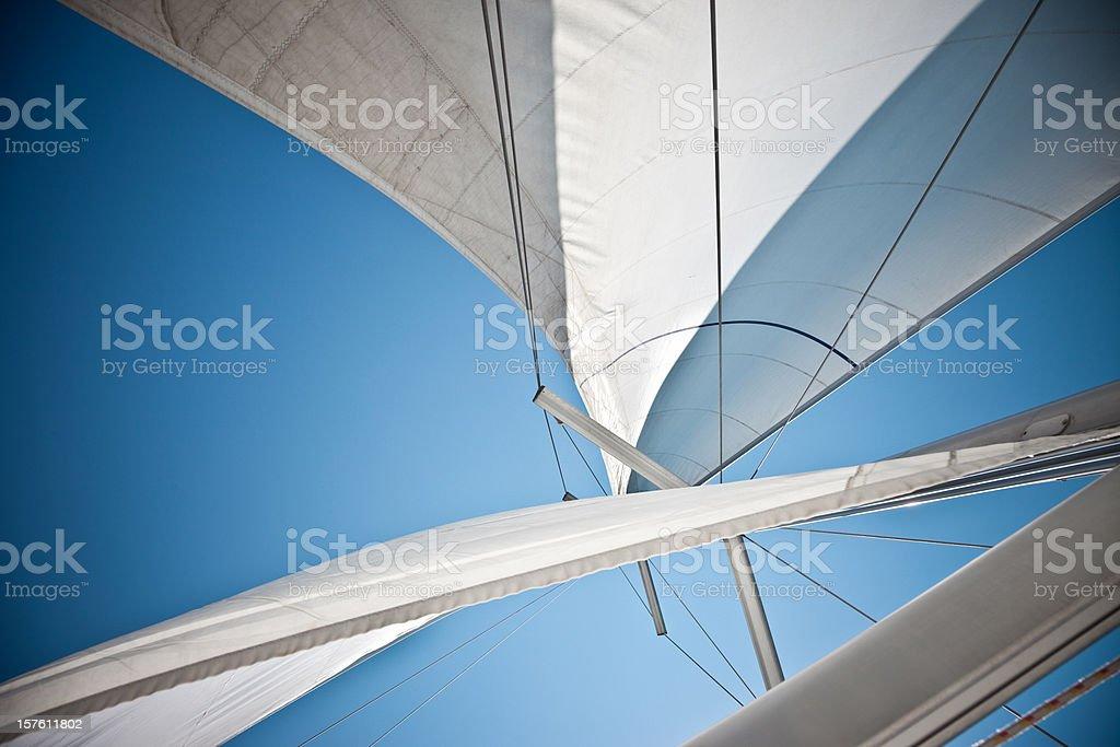 Sails Against A Clear Blue Sky stock photo