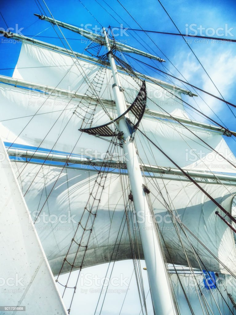 sails, mast and ropes view from below of a classic sailing ship. stock photo