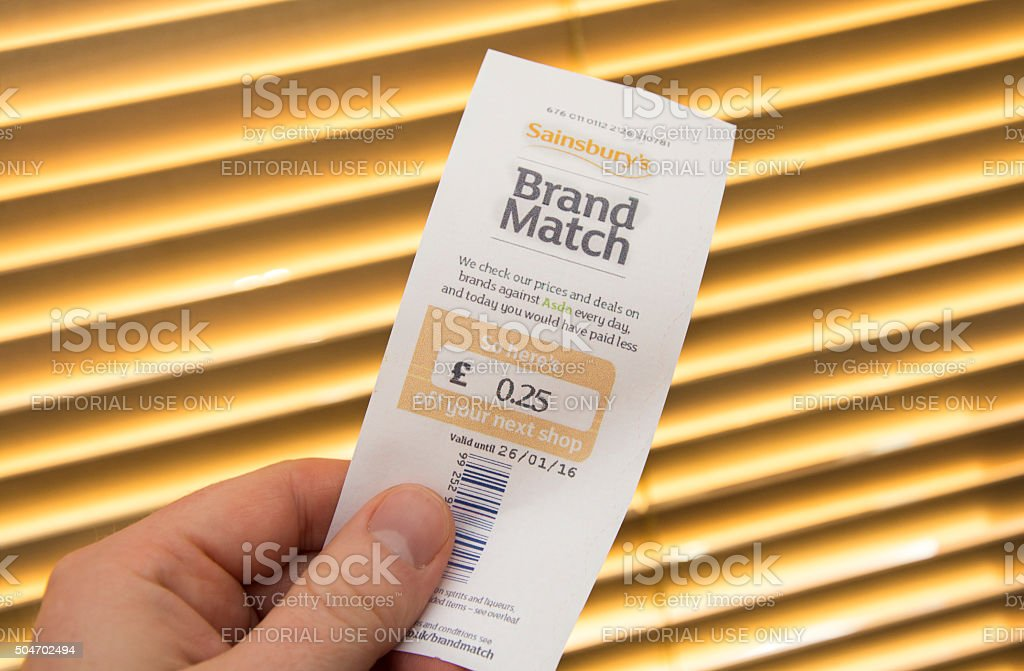 Holding a Sainsbury\'s \'Brand Match\' voucher given at the check out in...