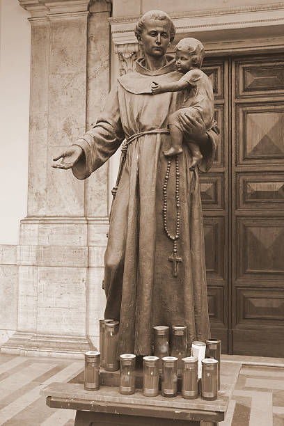 Saint Anthony of Padua Statue of Saint Anthony of Padua with child in front of the church of Sant' Antonio di Padova,on the Via Merulana in Rome, Italy. st. anthony of padua stock pictures, royalty-free photos & images