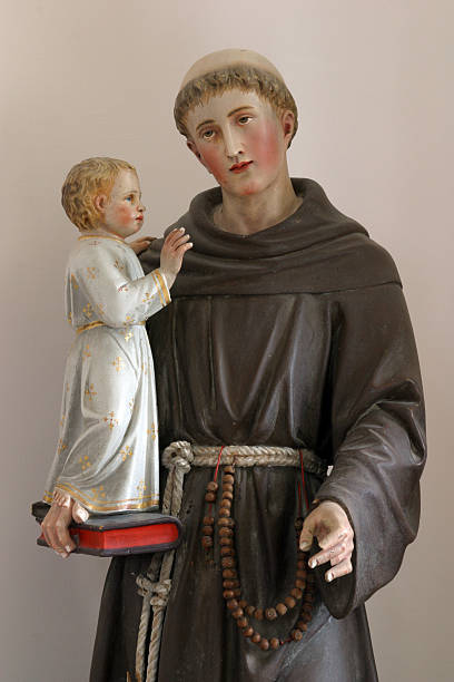 Saint Anthony of Padua Statue of St Anthony with the child Jesus st. anthony of padua stock pictures, royalty-free photos & images