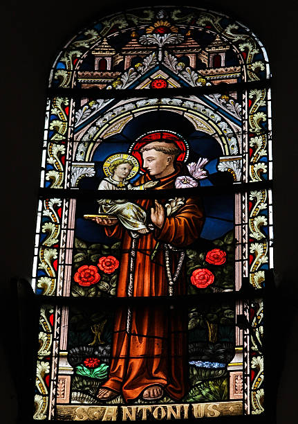 Saint Antonius Saint Antonius or Saint Anthony, stained glass window in the cathedral of Spa, Belgium,. This window was created in the early 19th Century, no property release is required. st. anthony of padua stock pictures, royalty-free photos & images