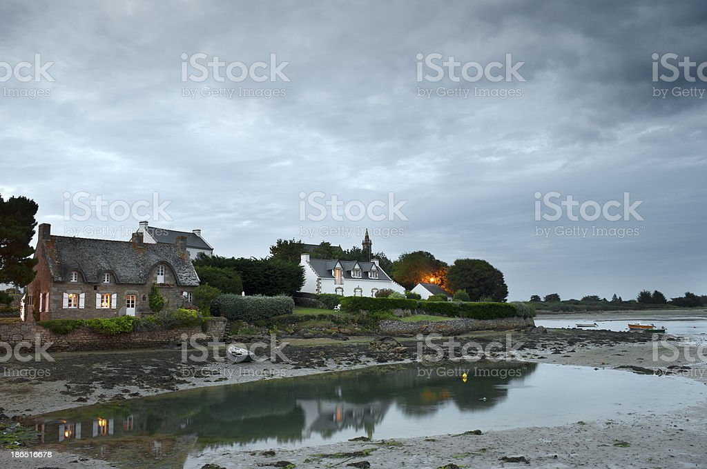 Saint Cado houses reflected in the sea at sunset royalty-free stock photo