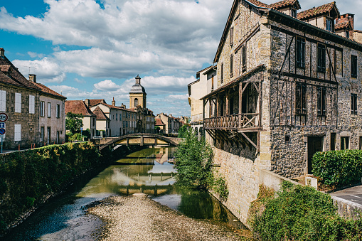 Looking along the Bave river at Quai des Recollets in the village of Saint Cere in the Dordogne region of France.