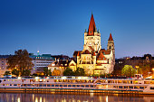 Saint Francis of Assisi Church on Danube in Vienna, Austria at nighttime