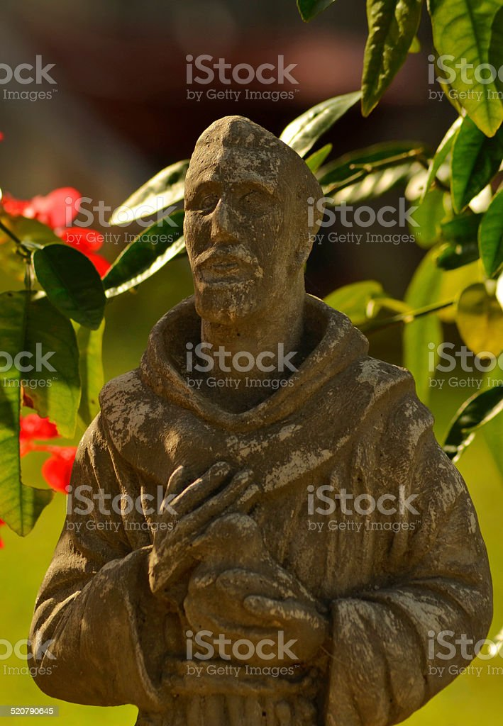 Saint Francis statue in the garden stock photo