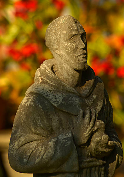 Saint Francis statue in the garden stock photo