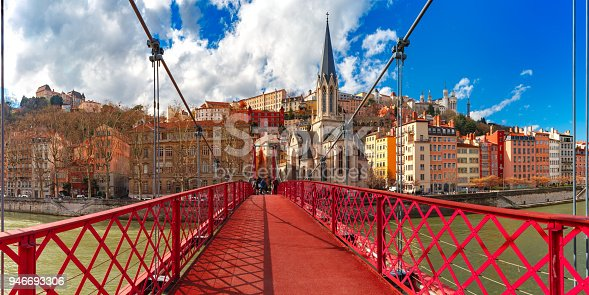 Panoramic view of Saint Georges church and pedestrian footbridge across Saone river, Old town with Fourviere cathedral in the sunny day in Lyon, France