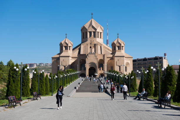 Saint Gregory the Illuminator Cathedral in Yerevan, Armenia People walk outside Saint Gregory the Illuminator Cathedral in Yerevan, Armenia yerevan stock pictures, royalty-free photos & images