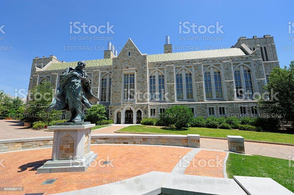 Saint Ignatius Loyala statue in front of Boston College building stock photo
