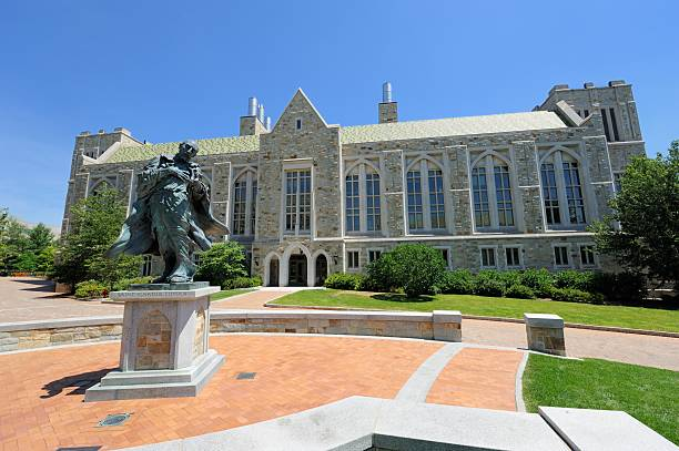 Saint Ignatius Loyala statue in front of Boston College building stock photo