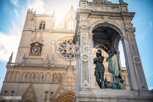 istock Saint Jean town square in Lyon French old town with majestic Saint-Jean-Baptiste Cathedral and statue for the baptism of Christ by John 1263912429