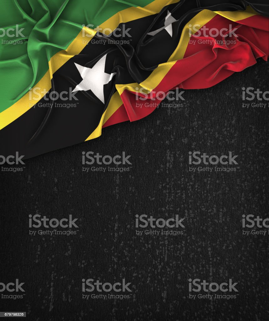 Saint Kitts and Nevis Flag Vintage on a Grunge Black Chalkboard With Space For Text stock photo