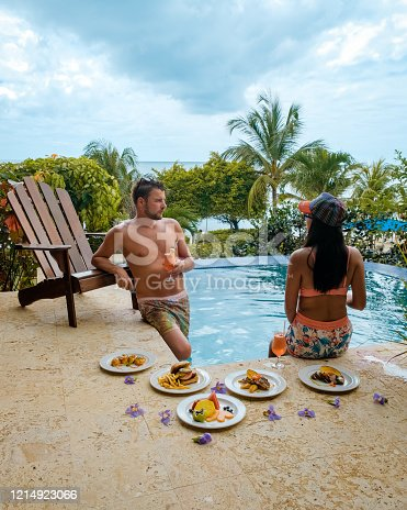 1055009962 istock photo Saint Lucia caribbean, couple on vacation at the tropical Island of St Lucia , men and woman on advenure trip 1214923066