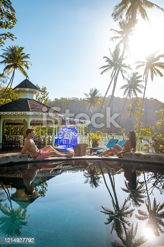 1055009962 istock photo Saint Lucia caribbean, couple on vacation at the tropical Island of St Lucia , men and woman on advenure trip 1214927792