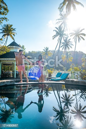 1055009962 istock photo Saint Lucia caribbean, couple on vacation at the tropical Island of St Lucia , men and woman on advenure trip 1214930557