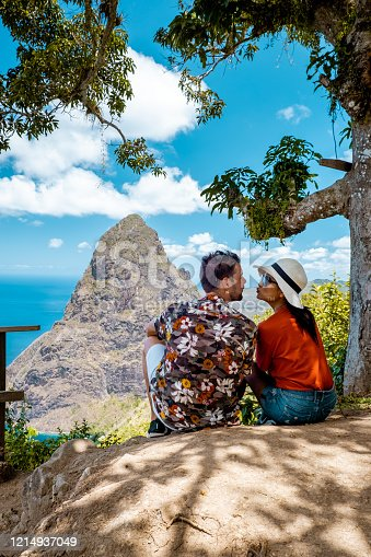 1055009962 istock photo Saint Lucia caribbean, couple on vacation at the tropical Island of St Lucia , men and woman on advenure trip 1214937049
