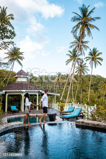 1055009962 istock photo Saint Lucia caribbean, couple on vacation at the tropical Island of St Lucia , men and woman on advenure trip 1214939864