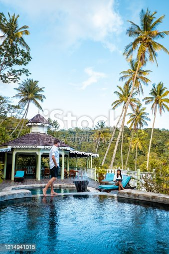 1055009962 istock photo Saint Lucia caribbean, couple on vacation at the tropical Island of St Lucia , men and woman on advenure trip 1214941015
